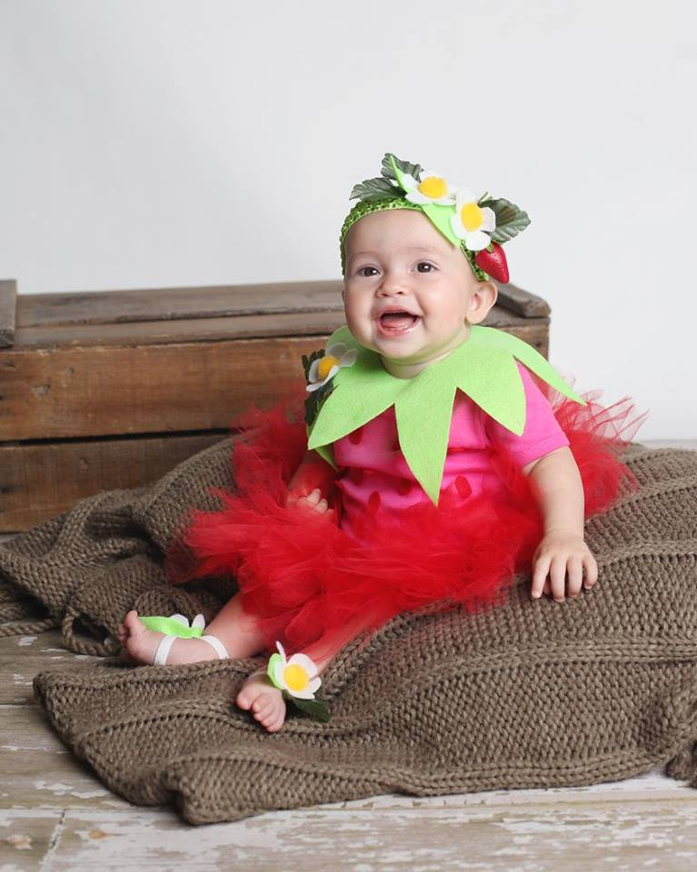 baby in strawberry costume