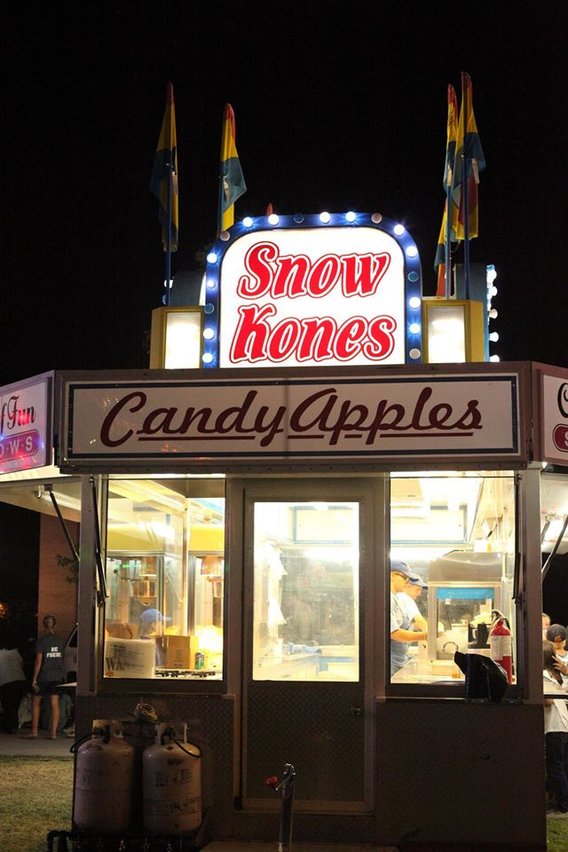 picture of snow kone stand and candy apples