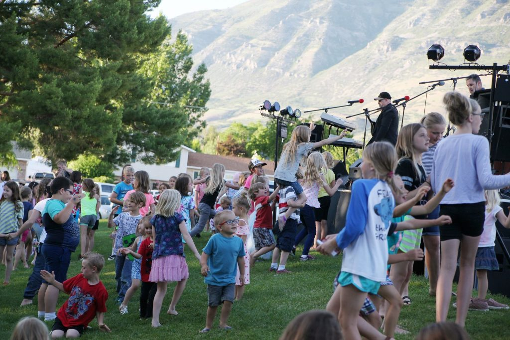 kids in field at concert