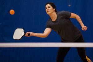 woman playing pickleball