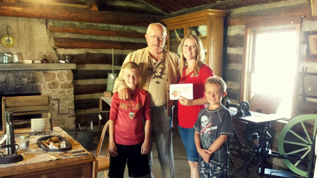 family in log cabin
