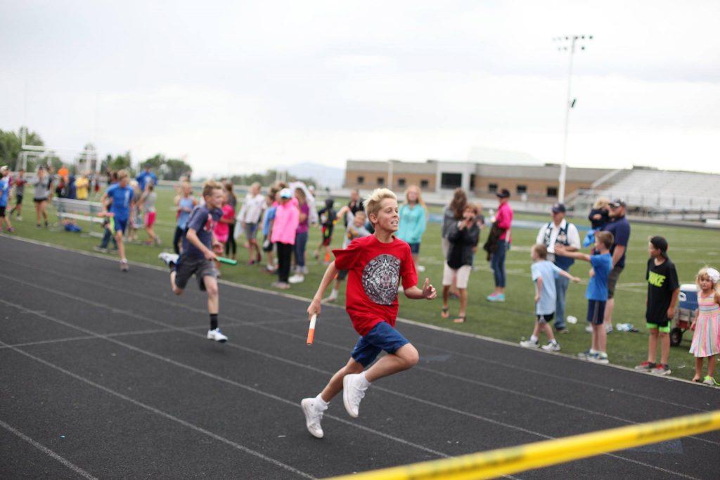 kid running on track